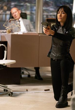 Maggie Q als Anne in The Protégé